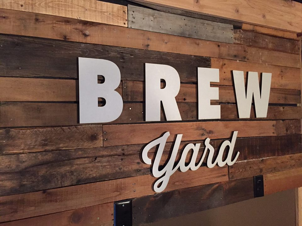 Precision-cut aluminum-faced acrylic dimensional letters mounted to rough-hewn wood panels gives rustic look to a local brew pub.