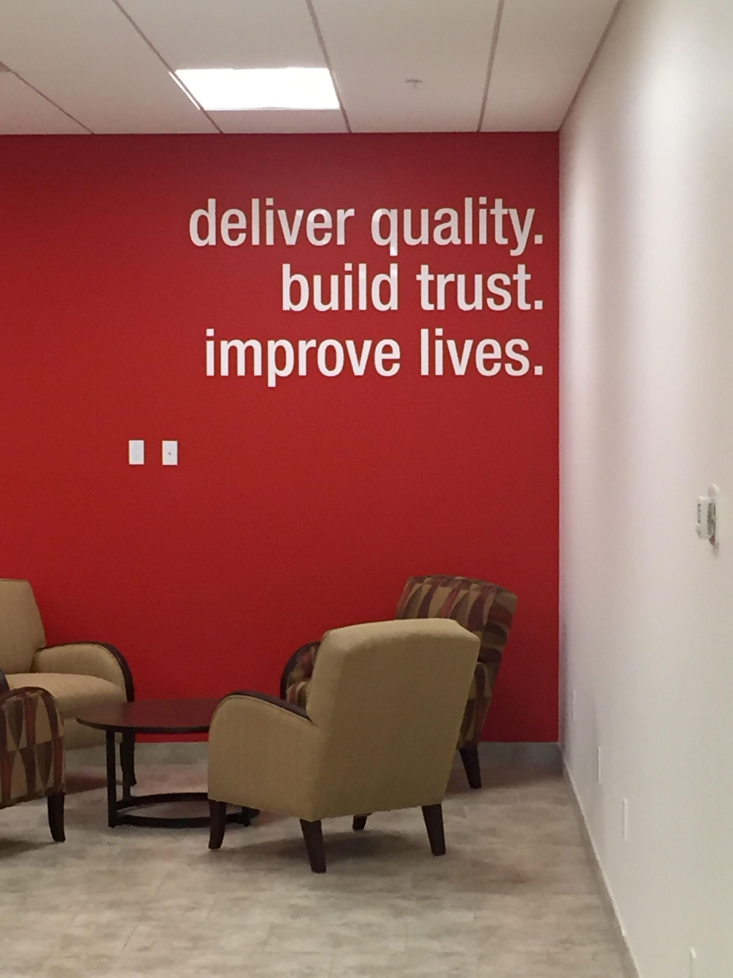 Laser cut white acrylic lettering, mounted directly to wall using precision installation template.