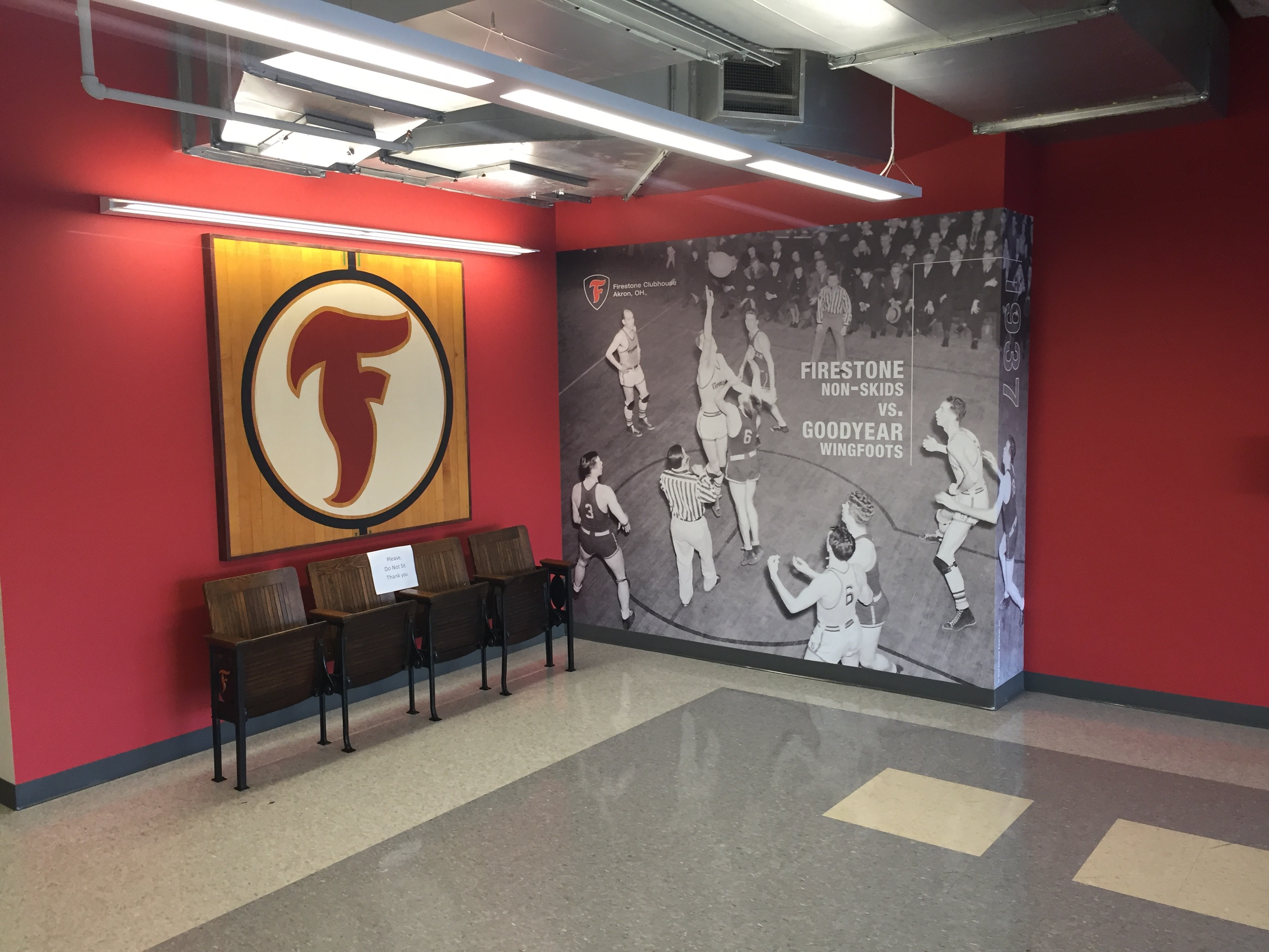 Custom printed wall covering helps tell the story of vintage corporate basketball arena artifacts.